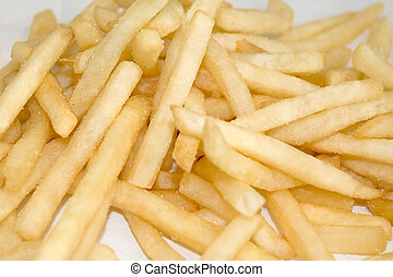 Fries - a pile of french fries on a napkin