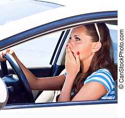 Fright face of woman in the car.