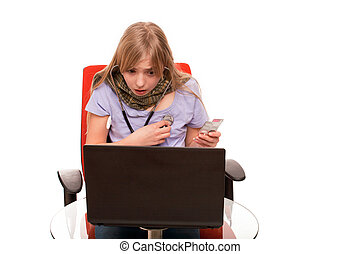 Hypochondria - Young Female checking herself with a stethoscope and searching information about her disease on a laptop.