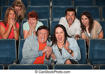 Frightened Audience - Group of frightened people screaming...