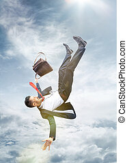 frightened businessman falling down and screaming