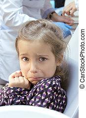 frightened girl at dentist's office