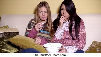 Frightened Girls Watching Horror Movie at Home - Two Young...