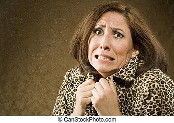 Portrait of a Hispanic woman recoiling in fear