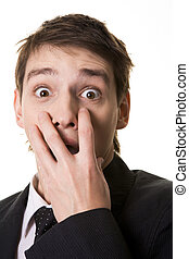 Frightened man - Image of shocked businessman hiding his...
