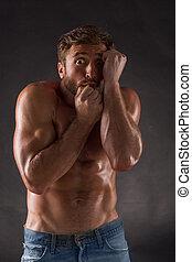 Frightened shirtless mascular man