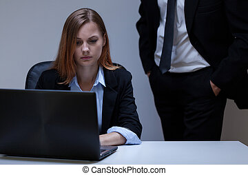Frightened woman in the office - View of frightened woman in...