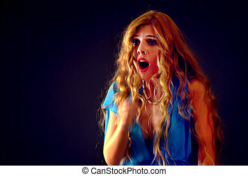 Frightened woman screaming with fear indoor at halloween...