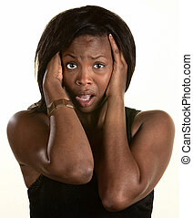 Frightened Black woman with hands on head