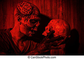 with a skull - Frightening bloody zombie man with a skull in...