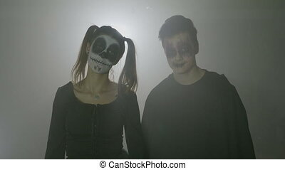 Frightening couple wearing carnival halloween costumes to...