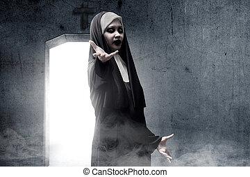 Frightening devil nun haunted the darkroom. Halloween ...