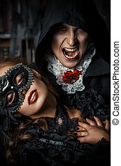 frightening kiss - Halloween carnival. Bloodthirsty male...