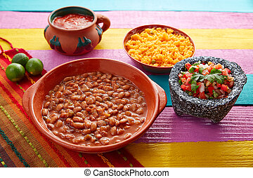 Frijoles mexican beans with rice and sauces nopal and pico...