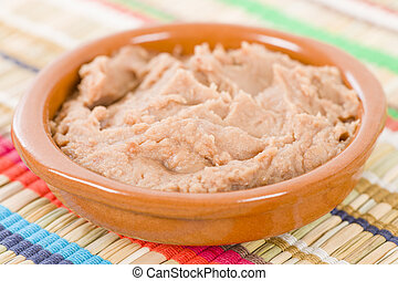Frijoles Refritos - Bowl of Mexican refried beans on a...