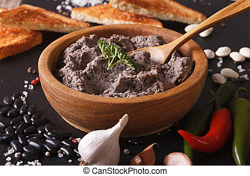 Frijoles refritos with ingredients close-up. Horizontal -...