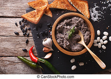 Frijoles refritos with ingredients close-up. Horizontal top...