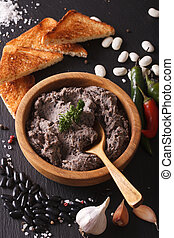 Frijoles refritos with ingredients close-up. Vertical -...