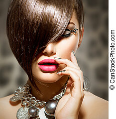 Fringe. Beauty Sexy Model Girl with Perfect Makeup and Manicure