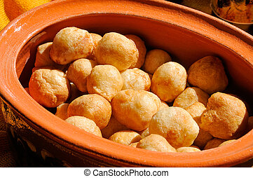 Fritters in the clay pot - Fritters with sugar powder on the...