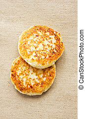 fritters of cottage cheese on kraft paper, top view