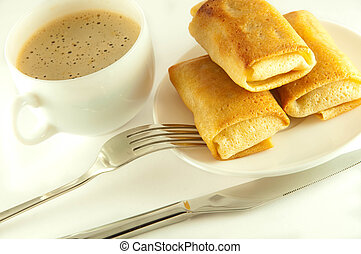 Fritters with a cup of coffee