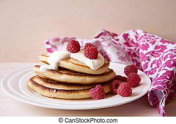 Fritters with a raspberry and sour cream
