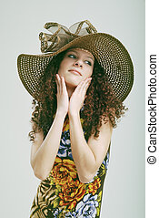 Frizzy girl in a hat.