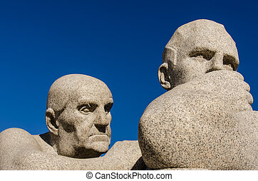 OSLO, NORWAY - JUNE 21: Statues in Vigeland park in Oslo, Norway on JUNE 21, 2012.The park covers 80 acres and features 212 bronze and granite sculptures created by Gustav Vigeland.