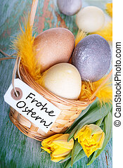 Frohe Ostern - Eggs in a Basket with a Label with the German...