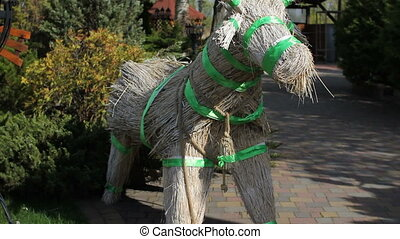 From straw and crop stalks made figurine of a donkey ....