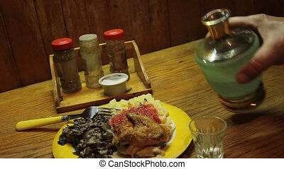 from the carafe pour into a glass of vodka for a snack -...