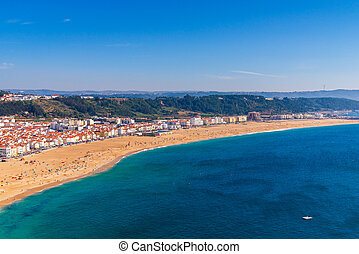 From the high point of the Nazare we can see the beach the sea and the village Nazare, Portugal