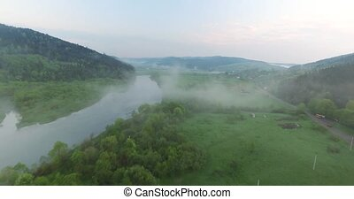 From the mountainside come down to the river a fog