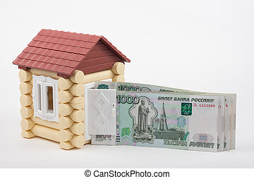 From the open door house sticks out a pack of thousandths Russian banknotes