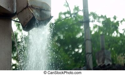 From the Roof water flows. slow motion. - With pipe roof...