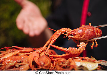 Close up of mans hands preparing crayfishes