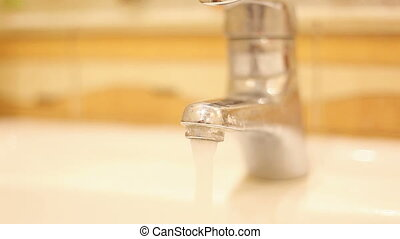 tap water flows - from the tap water flows. Video close-up,...
