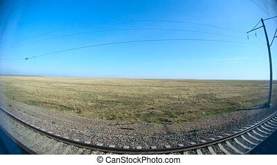 From train. - Steppe landscape through the window of an...