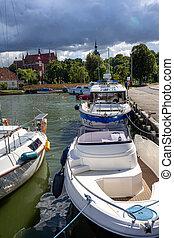 Frombork, Poland - Sept, 7, 2020: Marina and harbor for fishing boats in Frombrok on Vistula Lagoon. Poland.