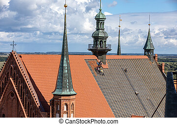 Frombork, Poland - Sept, 7, 2020: Renovation of the roof of the cathedral in Frombork. Poland