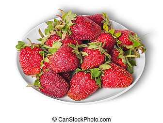 Front and top pile of fresh strawberries on white plate