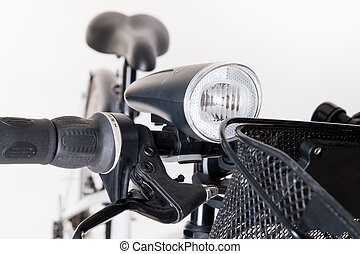 Front bicycle lamp on the steering wheel - studio shoot