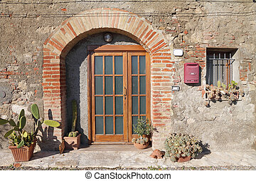 front door decorated with cactus plants
