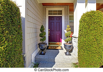 Front door in purple plum color with nice landscape.