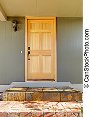 Front door light wood with green house close up. - Front ...