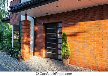 Front door of a modern brick house