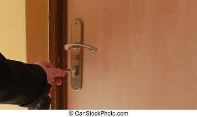 Opening apartment door with keys