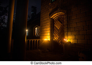 Front door to a house decorated with Halloween pumpkin. Halloween pumpkin on a door steep