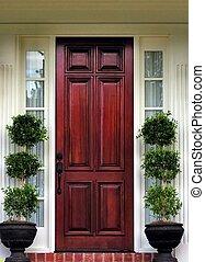 front door topiary - topiary plants at front door of home